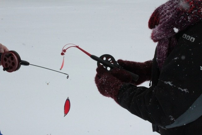Fishing in the snow and ice.
